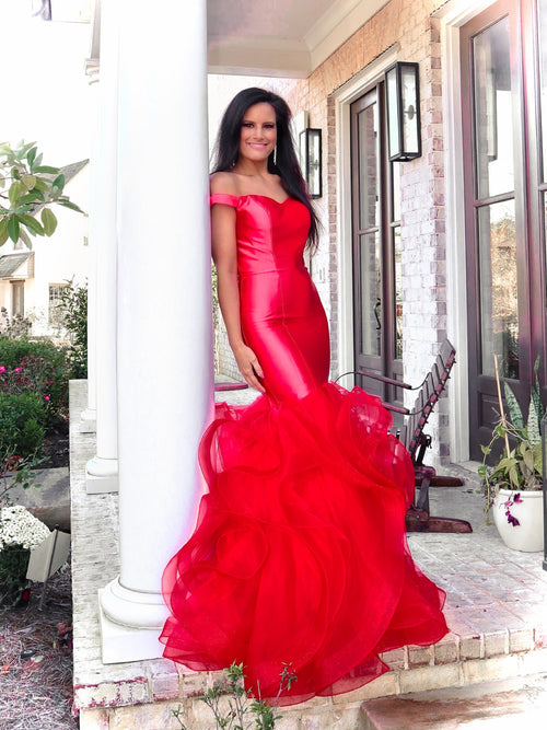 Model in this red off-the-shoulder evening gown with a super sophisticated mermaid silhouette! Perfect for ALL sizes up to size 22!! And it's at Rsvp Prom and Pageant, your source for the HOTTEST Prom and Pageant Dresses and exclusive evening gowns and located in Atlanta, Georgia!
