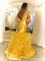 Back of Model lacking nothing in style in this bright yellow off-the-shoulder evening gown with a super sophisticated mermaid silhouette! Perfect for ALL sizes up to size 22!! And it's at Rsvp Prom and Pageant, your source for the HOTTEST Prom and Pageant Dresses and exclusive evening gowns and located in Atlanta, Georgia!