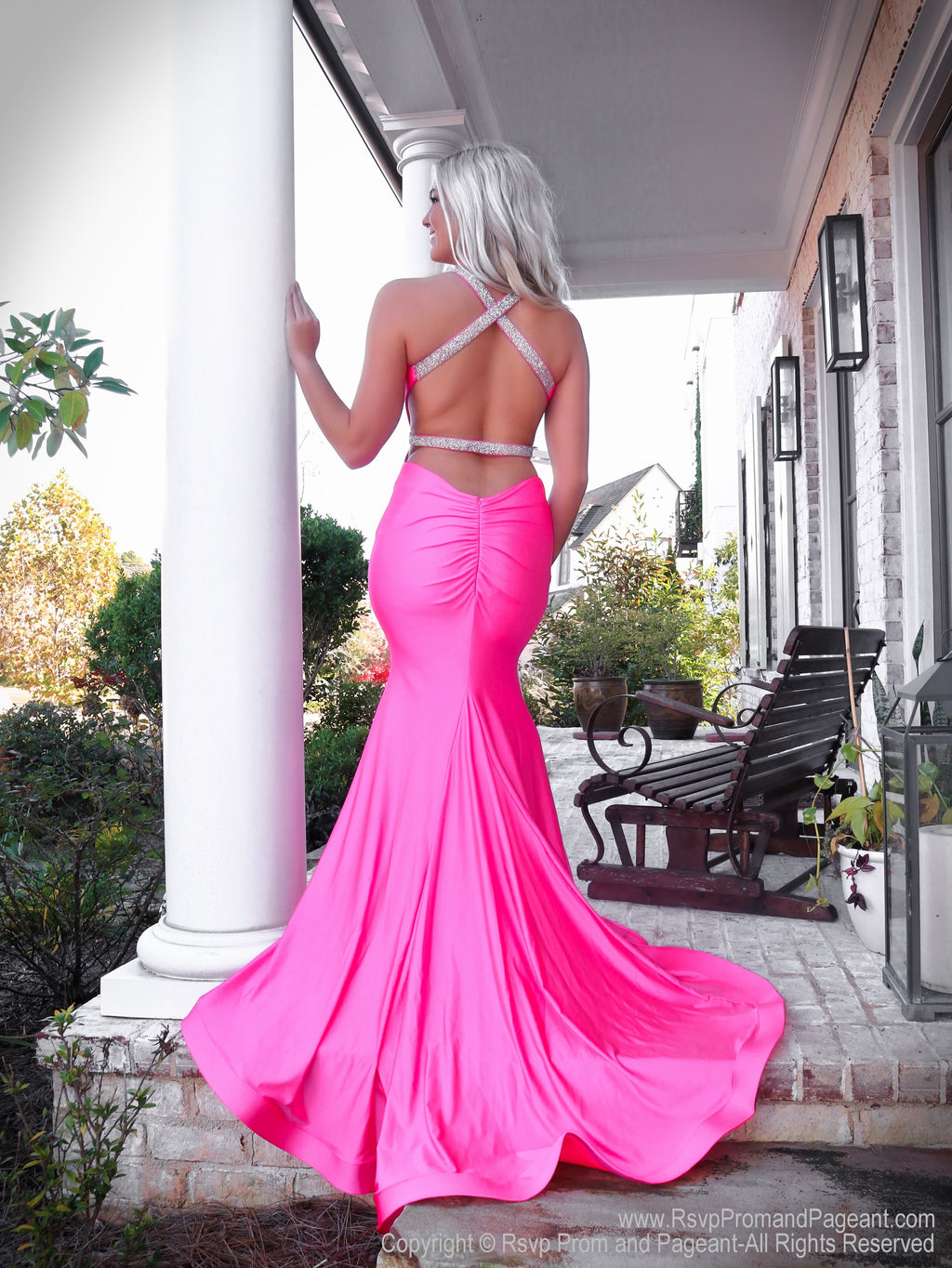 Back of model in this beautiful fit and flare prom dress with its sexy open back and sparkling beaded straps which makes it PERFECT for Prom! And it's at Rsvp Prom and Pageant, your source for the HOTTEST Prom and Pageant Dresses and Exclusive Evening Gowns and located in Atlanta, Georgia!