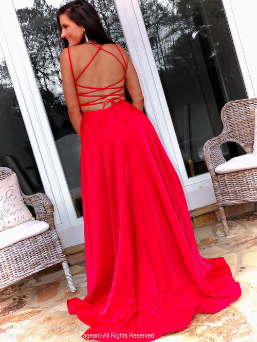 Back of model in this perfect-fit, open back, lace up Prom Dress with a sexy slit and most importantly POCKETS! And it's at Rsvp Prom and Pageant, your source for the HOTTEST Prom and Pageant Dresses and Exclusive Evening Gowns and located in Atlanta, Georgia!