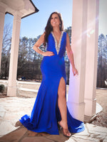 Model turning every head at prom in this sexy silver beaded v-neckline, open back Prom Dress with a daring slit! And it's at Rsvp Prom and Pageant, your source for the HOTTEST Prom and Pageant Dresses and Exclusive Evening Gowns and located in Atlanta, Georgia!