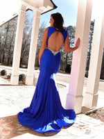 Back of model turning every head at prom in this sexy silver beaded v-neckline, open back Prom Dress with a daring slit! And it's at Rsvp Prom and Pageant, your source for the HOTTEST Prom and Pageant Dresses and Exclusive Evening Gowns and located in Atlanta, Georgia!