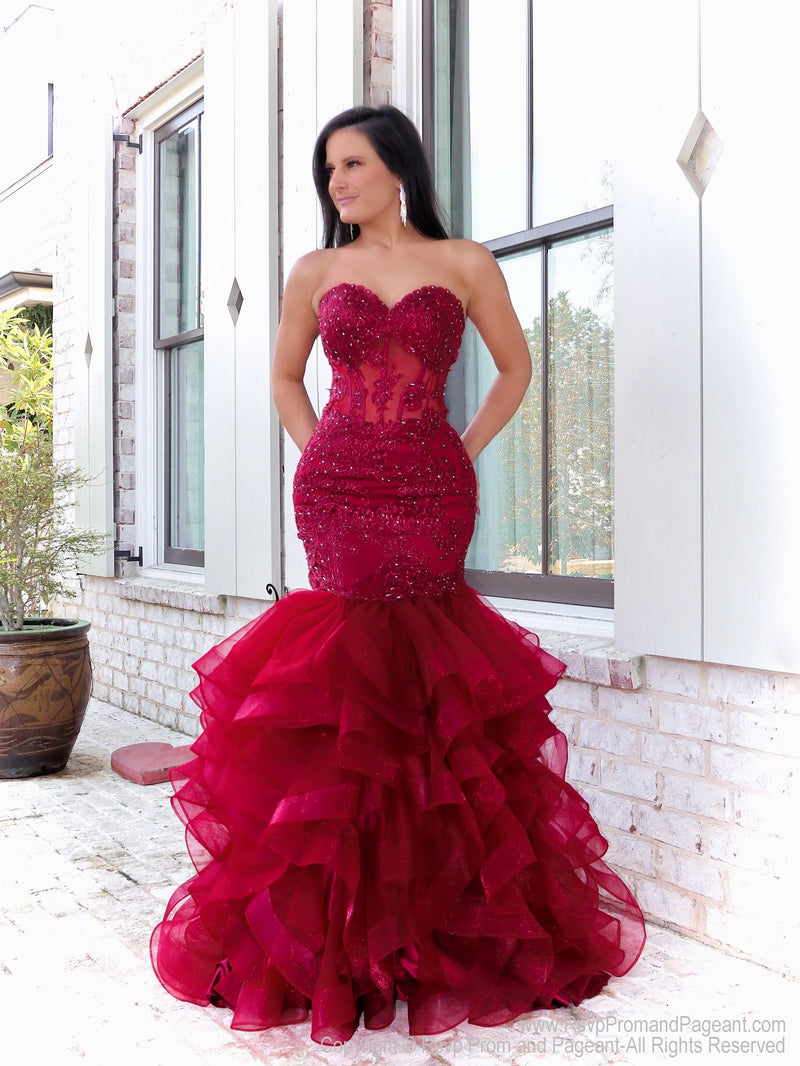 Pretty Model in this beautiful wine colored lace prom dress which is to die for with its ruffled mermaid silhouette and sheer midriff! You'll be the envy at the party! And its at RSVP Prom and Pageant, your source for the HOTTEST Prom and Pageant Dresses and Exclusive Evening Gowns and located in Atlanta, Georgia!
