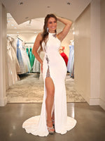 Model in this sexy, fitted, high neckline Prom Dress with a high slit! And its at RSVP Prom and Pageant, your source for the HOTTEST Prom and Pageant dresses and Exclusive Evening Gowns and located in Atlanta, Georgia!