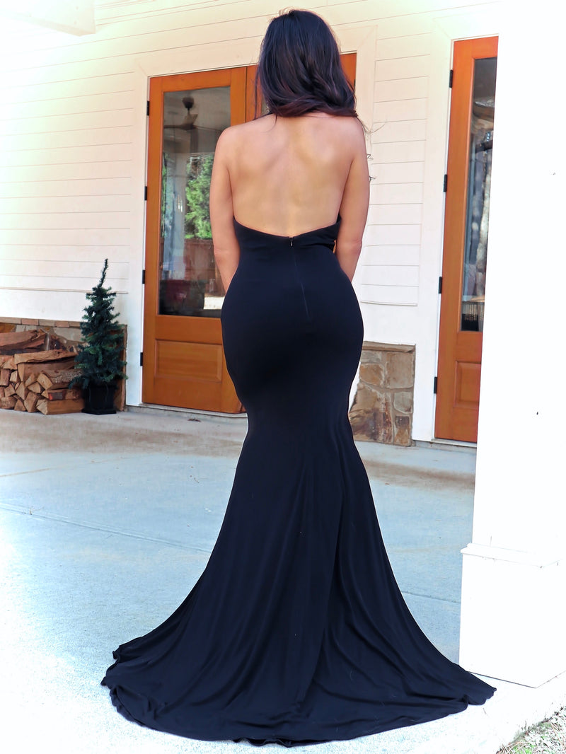 Back of model in this sexy, fitted, high neckline Prom Dress with a high slit! And its at RSVP Prom and Pageant, your source for the HOTTEST Prom and Pageant dresses and Exclusive Evening Gowns and located in Atlanta, Georgia!