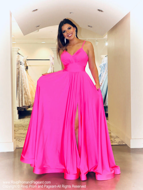 Model stunning everyone is this GORGEOUS flowing a-line Prom Dress with a to-die-for neckline and high slit! And its at RSVP Prom and Pageant, your source for the HOTTEST Prom and Pageant dresses and Exclusive Evening Gowns and located in Atlanta, Georgia!