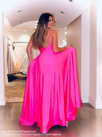 Back of Model stunning everyone is this GORGEOUS flowing a-line Prom Dress with a to-die-for neckline and high slit! And its at RSVP Prom and Pageant, your source for the HOTTEST Prom and Pageant dresses and Exclusive Evening Gowns and located in Atlanta, Georgia!