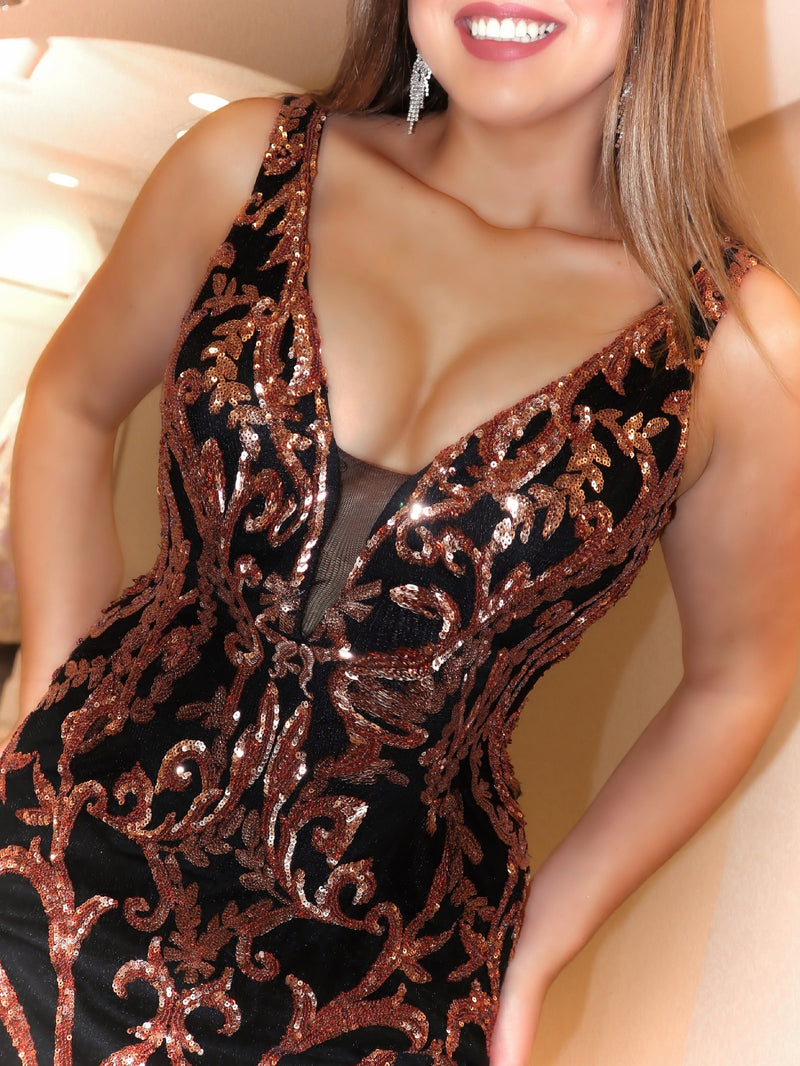 Closeup of model in this stunning rose gold/black mermaid Prom Dress featuring a plunging v-neckline and a low back. And its at RSVP Prom and Pageant, your source for the HOTTEST Prom and Pageant dresses and Exclusive Evening Gowns and located in Atlanta, Georgia!
