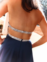 Closeup of back - This navy gown is to die for with its AB stone adorned v-neck that dips into a beautiful navy satin skirt with an open slit to show off your legs and pockets! And it's at Rsvp Prom and Pageant, your source for the HOTTEST Prom and Pageant Dresses and Exclusive Evening Gowns located in Atlanta, Georgia!