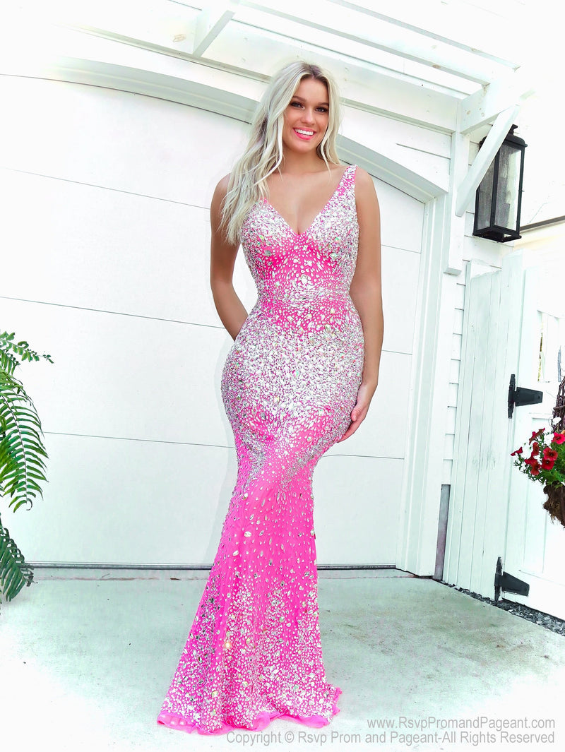 Model looking HOT in this Hot Pink formfitting, beaded prom dress with a V neckline! And it's at Rsvp Prom and Pageant, your source for the HOTTEST Prom and Pageant Dresses and Exclusive Evening Gowns and located in Atlanta, Georgia!
