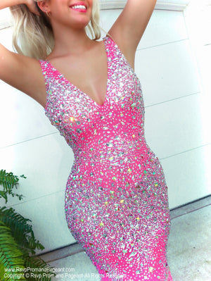 Closeup of Model looking HOT in this Hot Pink formfitting, beaded prom dress with a V neckline! And it's at Rsvp Prom and Pageant, your source for the HOTTEST Prom and Pageant Dresses and Exclusive Evening Gowns and located in Atlanta, Georgia!