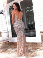Back of Model in this stunning fully beaded formfitting evening gown which will make jaws drop as she walk thru the door! With a low, open back and a v neckline, this is the dress of your dreams! And it's at Rsvp Prom and Pageant, your source for the HOTTEST Prom and Pageant Dresses and Exclusive Evening Gowns and located in Atlanta, Georgia!