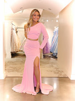 Model Gushing over this two piece Blush gown with one sleeve and slit! Rush to get this Blush dress because it will go fast!  And it's at Rsvp Prom and Pageant, your source for the HOTTEST Prom and Pageant Dresses and Exclusive Evening Gowns and located in Atlanta, Georgia!