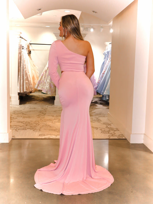 Back of model Gushing over this two piece Blush gown with one sleeve and slit! Rush to get this Blush dress because it will go fast!  And it's at Rsvp Prom and Pageant, your source for the HOTTEST Prom and Pageant Dresses and Exclusive Evening Gowns and located in Atlanta, Georgia!