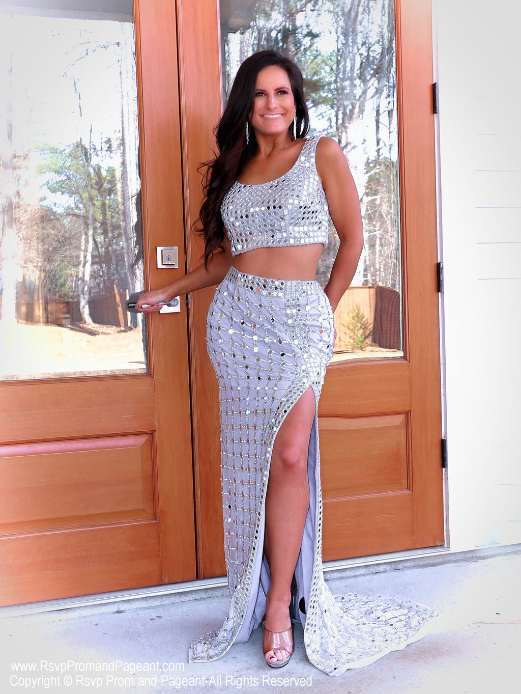 Model slaying in Silver! This absolutely STUNNING two piece sequin prom dress with a slit is perfect for your senior prom!  And it's at Rsvp Prom and Pageant, your source for the HOTTEST Prom and Pageant Dresses and Exclusive Evening Gowns and located in Atlanta, Georgia!