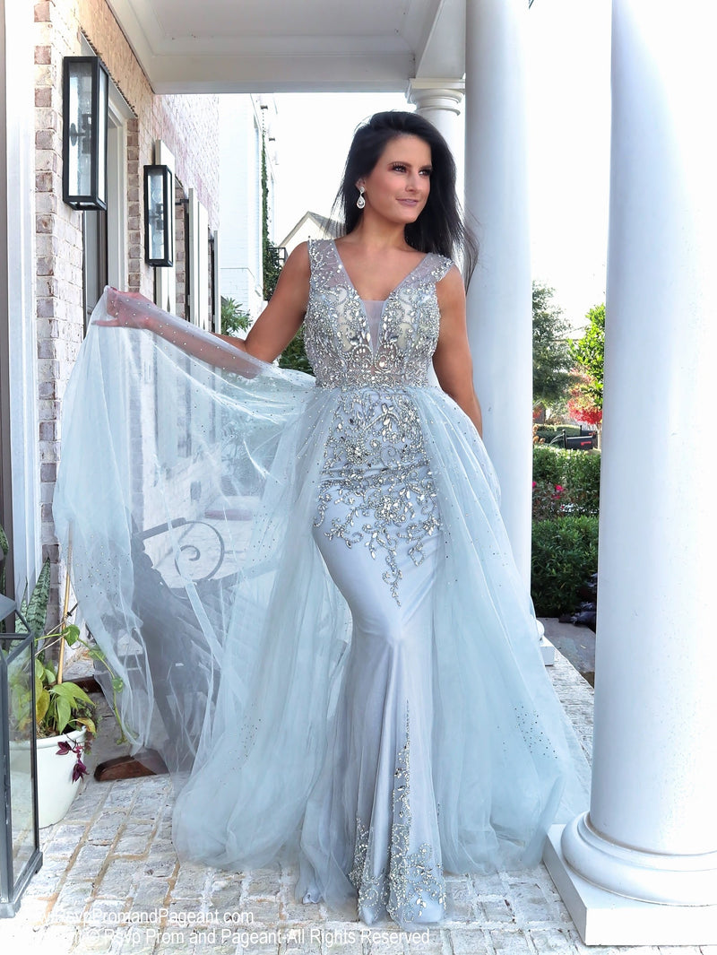 Pretty model in this stunning beaded evening gown that comes with an open back and a tulle overlay skirt that is perfect for strutting your stuff! Perfect for prom or pageant or any formal event! And it's at Rsvp Prom and Pageant, your source for the HOTTEST Prom and Pageant Dresses and exclusive evening gowns and located in Atlanta, Georgia!