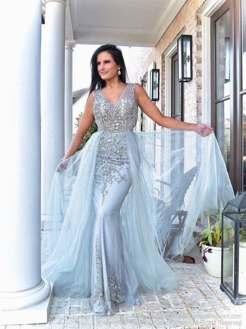 Gorgeous model in this stunning beaded evening gown that comes with an open back and a tulle overlay skirt that is perfect for strutting your stuff! Perfect for prom or pageant or any formal event! And it's at Rsvp Prom and Pageant, your source for the HOTTEST Prom and Pageant Dresses and exclusive evening gowns and located in Atlanta, Georgia!