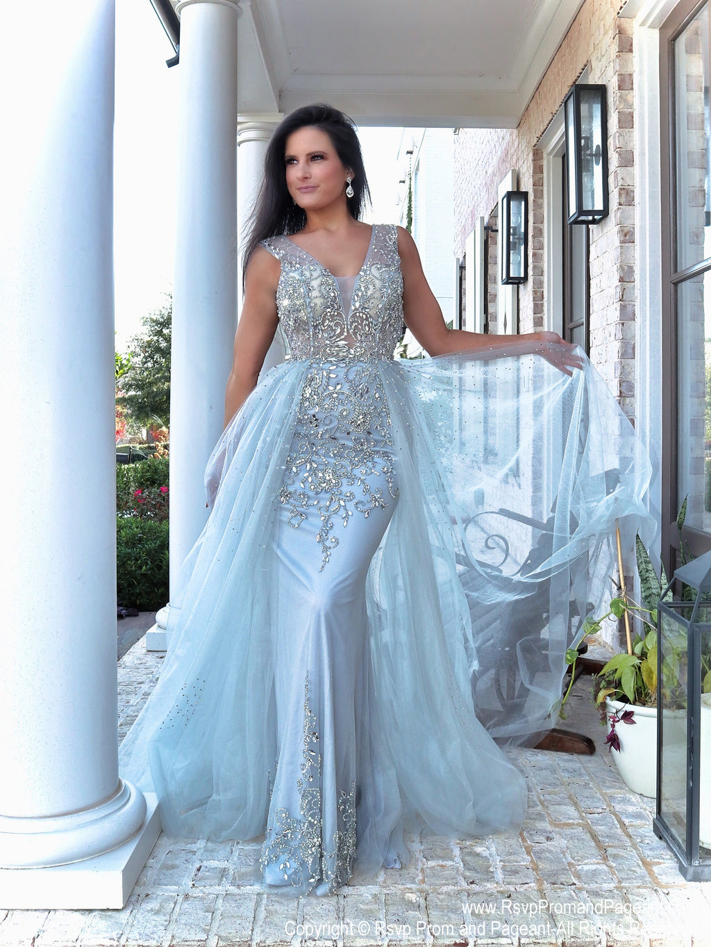 model in this stunning beaded evening gown that comes with an open back and a tulle overlay skirt that is perfect for strutting your stuff! Perfect for prom or pageant or any formal event! And it's at Rsvp Prom and Pageant, your source for the HOTTEST Prom and Pageant Dresses and exclusive evening gowns and located in Atlanta, Georgia!
