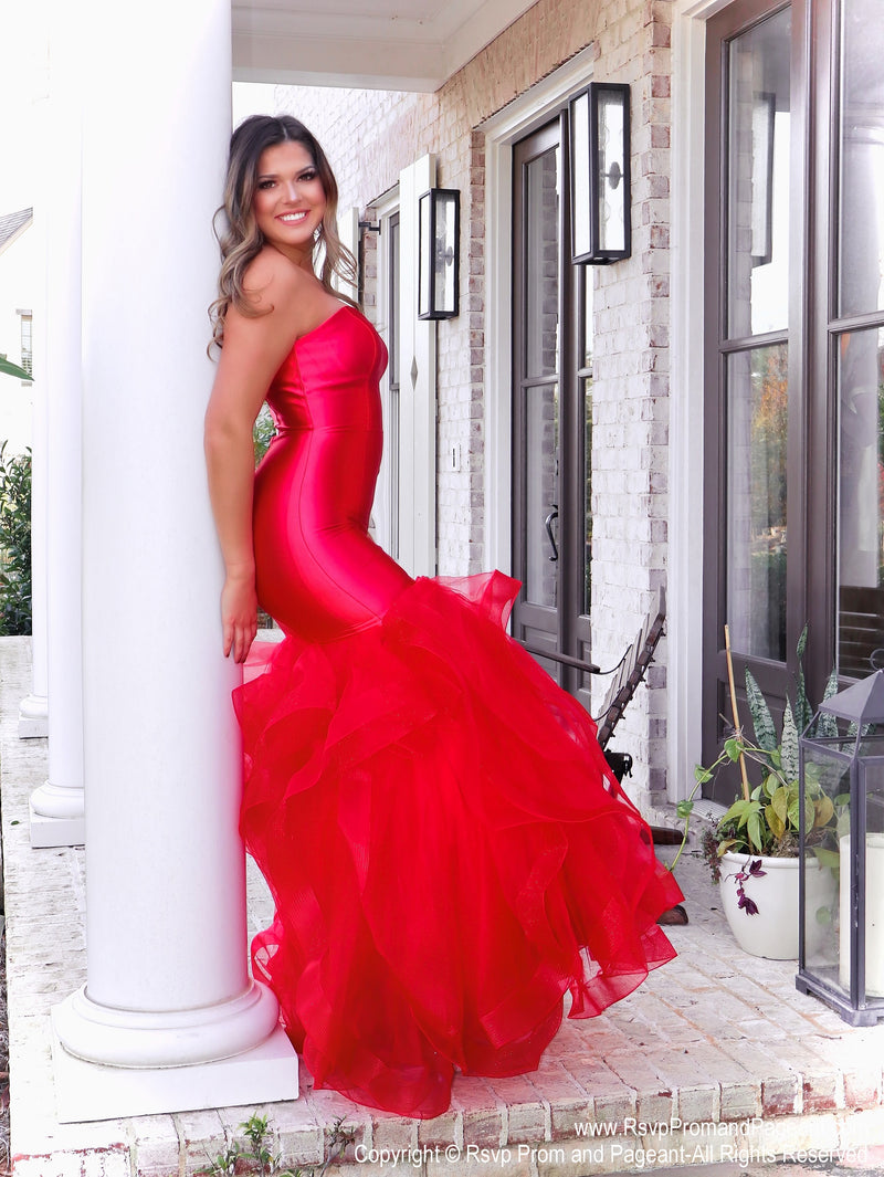 Model lacking nothing in style in this red strapless evening gown with a super sophisticated mermaid silhouette! Perfect for ALL sizes up to size 22!! And it's at Rsvp Prom and Pageant, your source for the HOTTEST Prom and Pageant Dresses and exclusive evening gowns and located in Atlanta, Georgia!