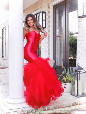 Pretty model lacking nothing in style in this red strapless evening gown with a super sophisticated mermaid silhouette! Perfect for ALL sizes up to size 22!! And it's at Rsvp Prom and Pageant, your source for the HOTTEST Prom and Pageant Dresses and exclusive evening gowns and located in Atlanta, Georgia!