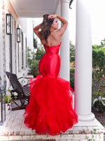 Back of model lacking nothing in style in this red strapless evening gown with a super sophisticated mermaid silhouette! Perfect for ALL sizes up to size 22!! And it's at Rsvp Prom and Pageant, your source for the HOTTEST Prom and Pageant Dresses and exclusive evening gowns and located in Atlanta, Georgia!