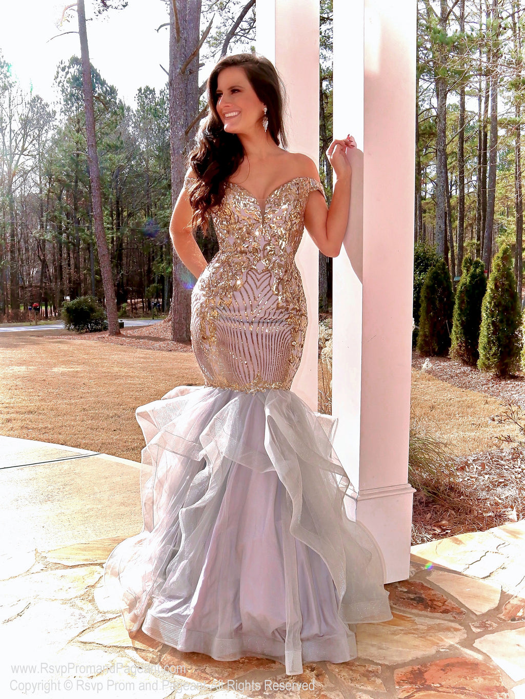 Model looking drop dead gorgeous in this spectacular off the shoulder sequin Silver/Gold mermaid gown!! And it's at Rsvp Prom and Pageant, your source for the HOTTEST Prom and Pageant Dresses and Exclusive Evening Gowns and located in Atlanta, Georgia!