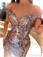 Closeup of Model looking drop dead gorgeous in this spectacular off the shoulder sequin Silver/Gold mermaid gown!! And it's at Rsvp Prom and Pageant, your source for the HOTTEST Prom and Pageant Dresses and Exclusive Evening Gowns and located in Atlanta, Georgia!