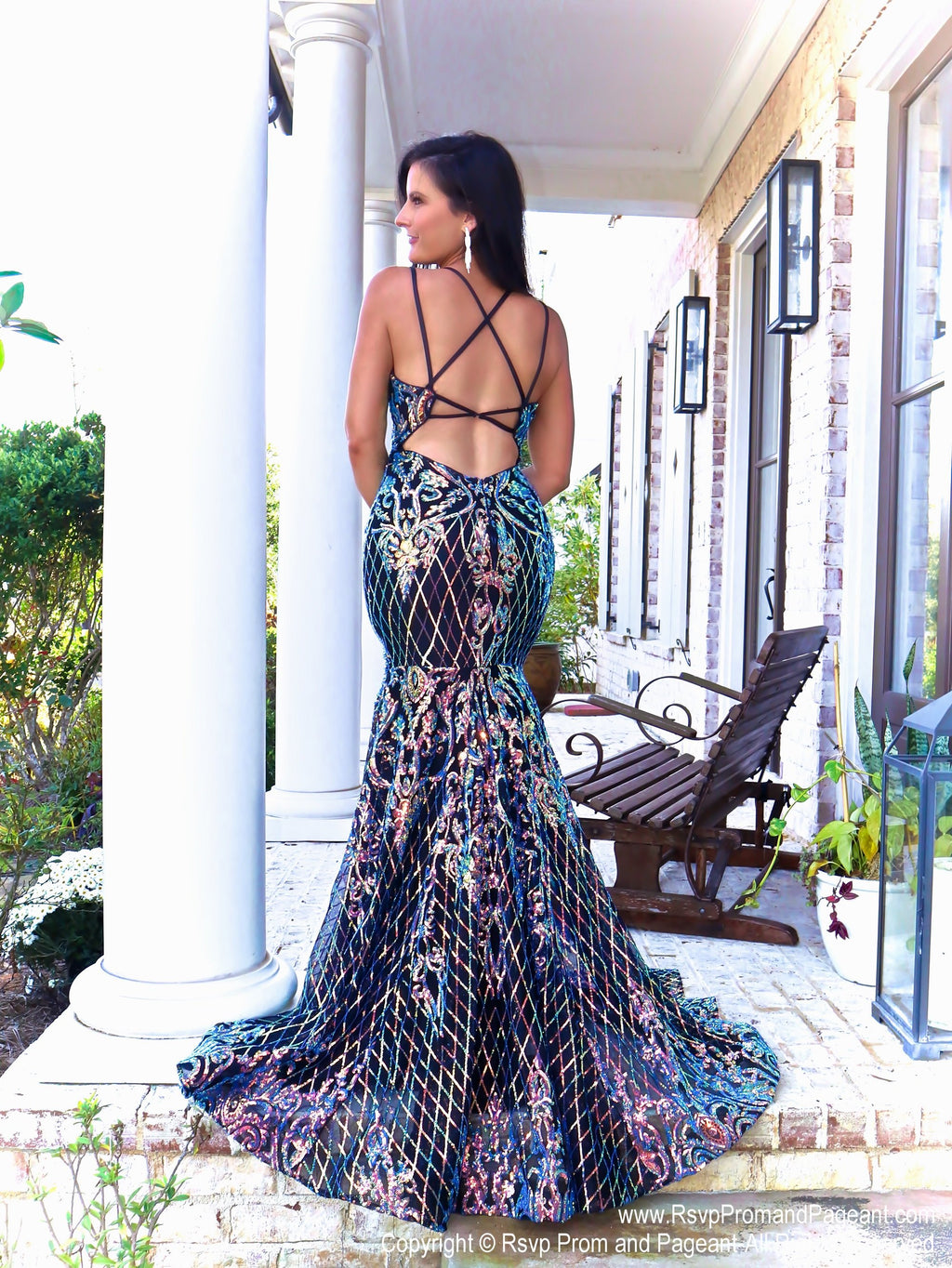 Back of Model in this Iridescent mermaid gown with an open, strappy back and an intricate sequined design which is unlike anything else!! And it's at Rsvp Prom and Pageant, your source for the HOTTEST Prom and Pageant Dresses and Exclusive Evening Gowns and located in Atlanta, Georgia!