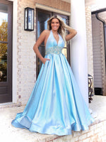 Pretty Model looking and feeling like a princess in this stunning light blue ball gown featuring a Halter Neckline and pockets! And it's at Rsvp Prom and Pageant, your source for the HOTTEST Prom and Pageant Dresses and Exclusive Evening Gowns and located in Atlanta, Georgia!