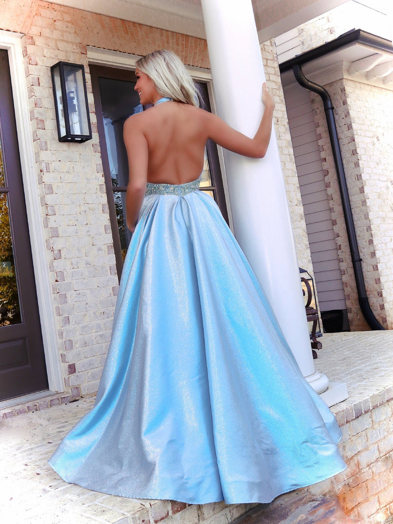 Back of Model looking and feeling like a princess in this stunning light blue ball gown featuring a Halter Neckline and pockets! And it's at Rsvp Prom and Pageant, your source for the HOTTEST Prom and Pageant Dresses and Exclusive Evening Gowns and located in Atlanta, Georgia!