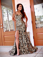 Model in this stunning Black/Gold sequin gown with an open, strappy back and slit which is the perfect dress for prom or any fancy occasion!! And its at RSVP Prom and Pageant, your source for the HOTTEST Prom and Pageant Dresses and Exclusive Evening Gowns and located in Atlanta, Georgia!