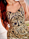 Closeup of Model in this stunning Black/Gold sequin gown with an open, strappy back and slit which is the perfect dress for prom or any fancy occasion!! And its at RSVP Prom and Pageant, your source for the HOTTEST Prom and Pageant Dresses and Exclusive Evening Gowns and located in Atlanta, Georgia!