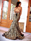Back of Model in this stunning Black/Gold sequin gown with an open, strappy back and slit which is the perfect dress for prom or any fancy occasion!! And its at RSVP Prom and Pageant, your source for the HOTTEST Prom and Pageant Dresses and Exclusive Evening Gowns and located in Atlanta, Georgia!