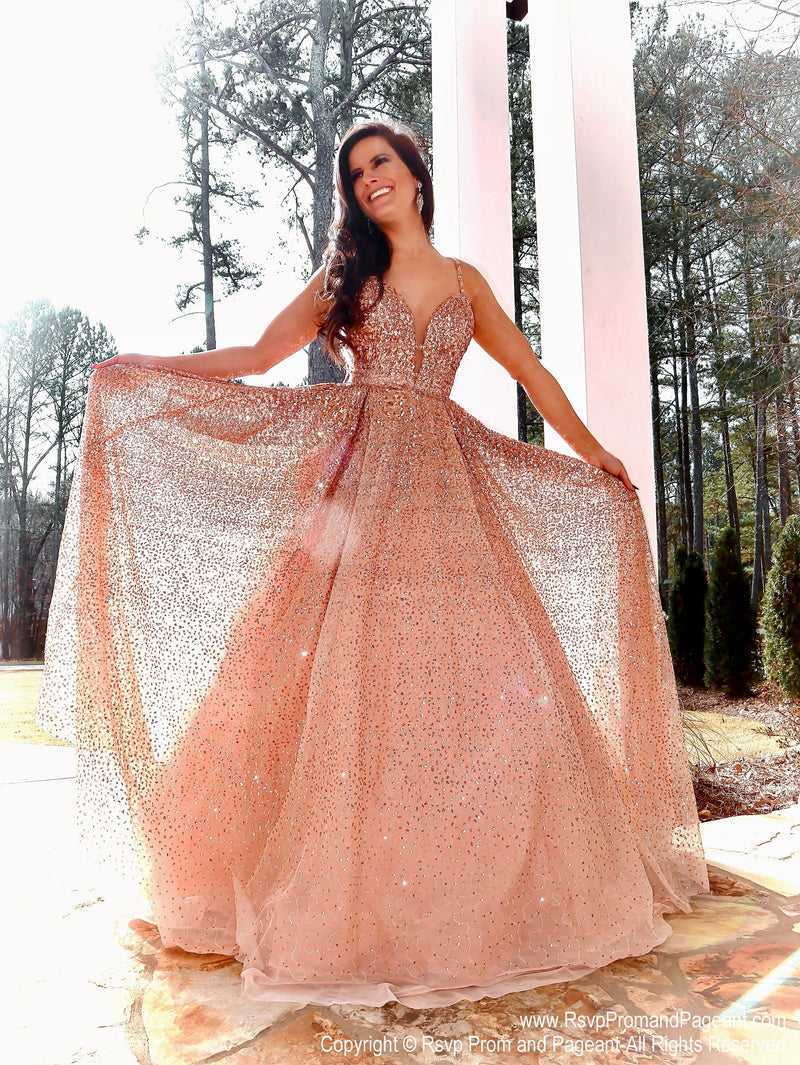Model in this Rose Gold ball gown which is the definition of Prom Heaven!! The ombre sequins, open sides, sparkling beading, and beautiful color will have you beaming all night!  And it's at Rsvp Prom and Pageant, your source for the HOTTEST prom and pageant dresses and Exclusive Evening Gowns and located in Atlanta, Georgia!
