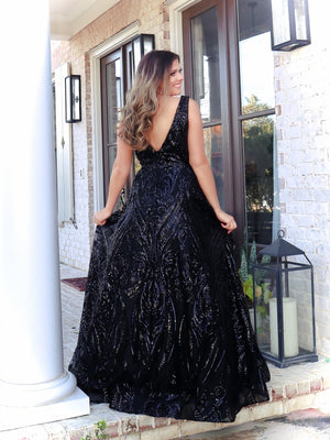 Back of Model in this black ball gown which is perfect for senior prom with the v neckline and sequins all over, you will shimmer and sparkle all night! Not to mention, it has POCKETS! And it's at Rsvp Prom and Pageant, your source for the HOTTEST Prom and Pageant Dresses and Exclusive Evening Gowns and located in Atlanta, Georgia!