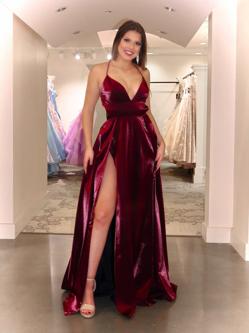 Model in this gorgeous satin dress featuring a fully exposed lace-up open back and not only one but two high slits! And it's at Rsvp Prom and Pageant, your source for the HOTTEST Prom and Pageant Dresses and Exclusive Evening Gowns located in Atlanta, Georgia!