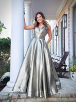 Pretty Model turning every head in this stunning iridescent platinum gold Prom Dress! Its sweetheart neckline and all-over shimmer makes it an unforgettable look! And it's at Rsvp Prom and Pageant, your source of the HOTTEST Prom and Pageant Dresses and Exclusive Evening Gowns and located in Atlanta, Georgia!
