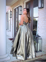 Back of Model turning every head in this stunning iridescent platinum gold Prom Dress! Its sweetheart neckline and all-over shimmer makes it an unforgettable look! And it's at Rsvp Prom and Pageant, your source of the HOTTEST Prom and Pageant Dresses and Exclusive Evening Gowns and located in Atlanta, Georgia!