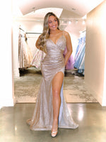 Model in this STUNNING gold/silver ombre Prom Dress. It features a sweetheart neckline, all-over shimmer, and a high slit! And its at RSVP Prom and Pageant, your source for the HOTTEST Prom and Pageant Dresses and Exclusive Evening Gowns located in Atlanta, Georgia!