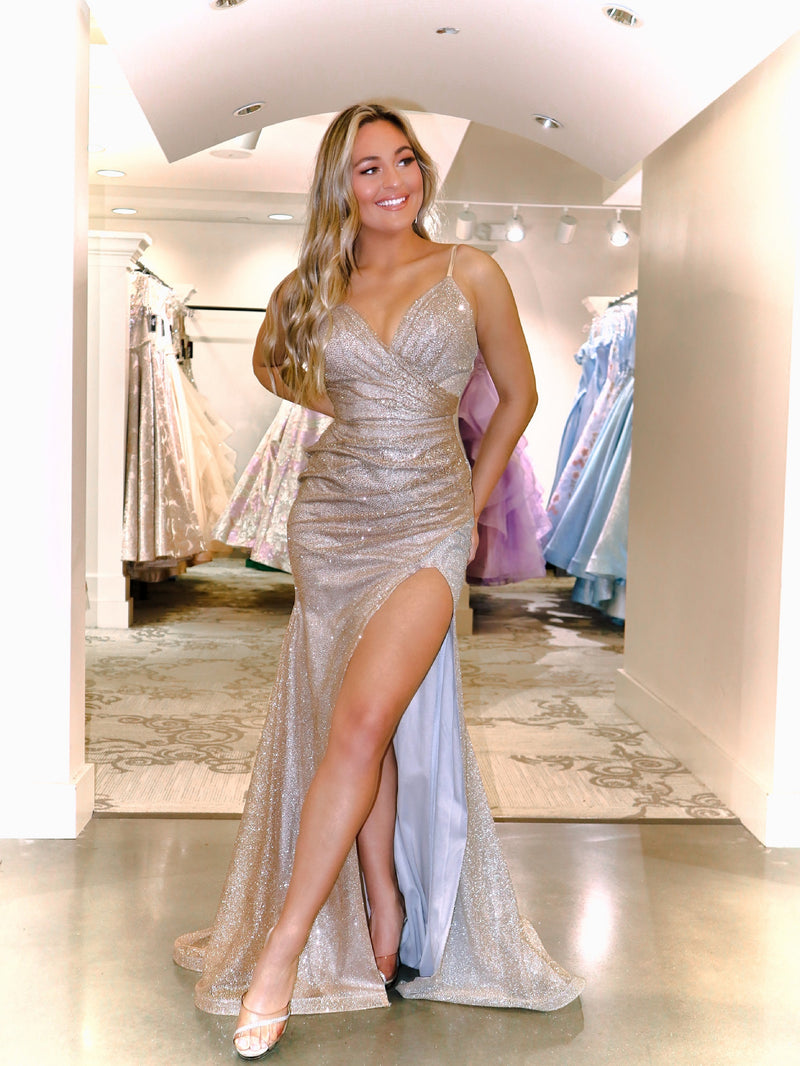 Beautiful model in this STUNNING gold/silver ombre Prom Dress. It features a sweetheart neckline, all-over shimmer, and a high slit! And its at RSVP Prom and Pageant, your source for the HOTTEST Prom and Pageant Dresses and Exclusive Evening Gowns located in Atlanta, Georgia!