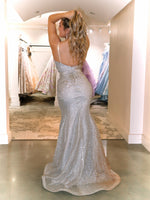 Back of model in this STUNNING gold/silver ombre Prom Dress. It features a sweetheart neckline, all-over shimmer, and a high slit! And its at RSVP Prom and Pageant, your source for the HOTTEST Prom and Pageant Dresses and Exclusive Evening Gowns located in Atlanta, Georgia!