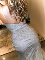 Closeup of back of model in this STUNNING gold/silver ombre Prom Dress. It features a sweetheart neckline, all-over shimmer, and a high slit! And its at RSVP Prom and Pageant, your source for the HOTTEST Prom and Pageant Dresses and Exclusive Evening Gowns located in Atlanta, Georgia!