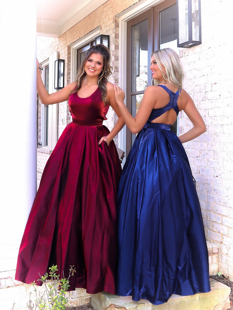 Front and Back of beautiful models in this fun and flirty ball gown featuring a scoop neckline, racer back and pockets. And it's at Rsvp Prom and Pageant, your source for the HOTTEST Prom and Pageant Dresses and Exclusive Evening Gowns and located in Atlanta, Georgia