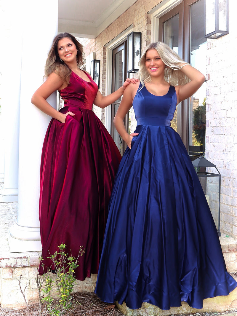 Beautiful models in this fun and flirty ball gown featuring a scoop neckline, racer back and pockets. And it's at Rsvp Prom and Pageant, your source for the HOTTEST Prom and Pageant Dresses and Exclusive Evening Gowns and located in Atlanta, Georgia