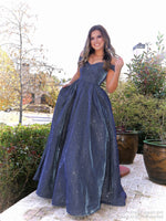 Model in this gorgeous mermaid dress featuring a sweetheart neckline, off the shoulder straps and a shimmer/iridescent material all over and let's not forget about the pockets! And it's at Rsvp Prom and Pageant, your source for the HOTTEST Prom and Pageant Dresses and Exclusive Evening Gowns and located in Atlanta, Georgia!