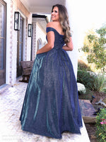 Back of Model in this gorgeous mermaid dress featuring a sweetheart neckline, off the shoulder straps and a shimmer/iridescent material all over and let's not forget about the pockets! And it's at Rsvp Prom and Pageant, your source for the HOTTEST Prom and Pageant Dresses and Exclusive Evening Gowns and located in Atlanta, Georgia!