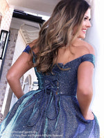 Closeup of back of Model in this gorgeous mermaid dress featuring a sweetheart neckline, off the shoulder straps and a shimmer/iridescent material all over and let's not forget about the pockets! And it's at Rsvp Prom and Pageant, your source for the HOTTEST Prom and Pageant Dresses and Exclusive Evening Gowns and located in Atlanta, Georgia!