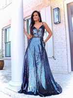 Model making a statement in this stunning fully sequined, ball gown Prom Dress! It features a beaded belt along the waist-line, and an open strappy back! And its at RSVP Prom and Pageant, your source for the HOTTEST Prom and Pageant Dresses and exclusive evening gowns and located in Atlanta, Georgia!