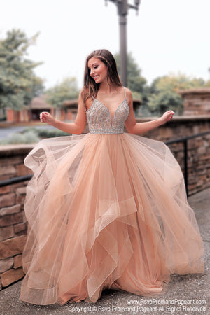 Model in Gold Multi Layered Beaded Ball Gown at Rsvp Prom and Pageant, the largest Atlanta prom dress store also known as promheaven