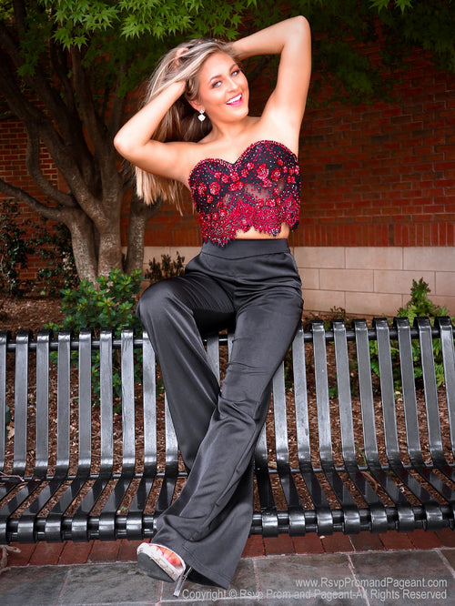 Cute girl sitting on a bench in a red and black pant set at Rsvp Prom and Pageant, Snellville, Georgia